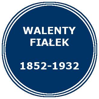 Niebieskie koło. Napis: Walenty Fiałek 1852-1932